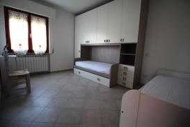 Agenzia_immobiliare_il_molo_Castiglione_della_Pescaia_appartamento_in_affitto_cameretta